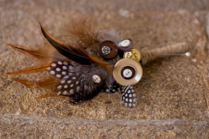 feather and button boutoniere