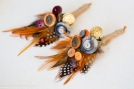 feather and button boutonniere, buttonhole